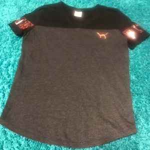 Gray black and rose gold/ pink brand shirt